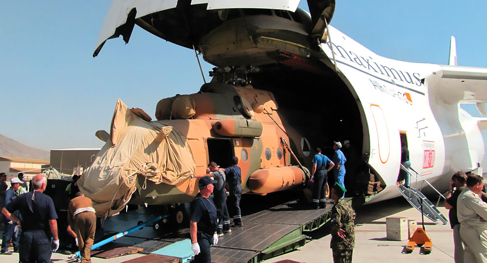Helicopter inside cargo airplane